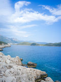 Aegean Sea Inlet at Kas, Turkey. Rout D400, the famous road for self-driving tourists, is at left of the dark-blue inlet, while Kas Peninsula at right royalty free stock photo