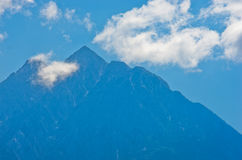 Aegean sea, silhouette of the holy mountains Athos and a small cloud above the mountain top Stock Photo