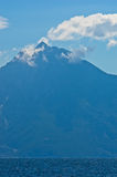 Aegean sea, silhouette of the holy mountains Athos and a small cloud above the mountain top Royalty Free Stock Photo