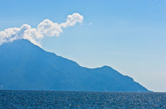 Aegean sea, silhouette of the holy mountains Athos and a small cloud above the mountain top Royalty Free Stock Image
