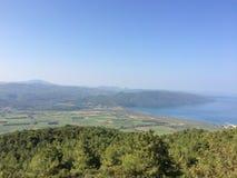 Aegean Sea. Turkey. Warm Aegean Sea, green fields and mountain views royalty free stock photography