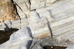 Aegean seashore and marble rocks in Aliki, Thassos island Royalty Free Stock Images