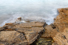 Aegean shore in Greece, Thassos island - waves and rocks - long exposure Stock Photo