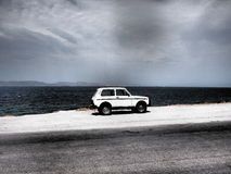 Aegina, Greece car parked by ocean Royalty Free Stock Photos