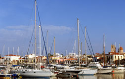 Aegina harbour. Luxury yachts lined up in the main town's harbour on Aegina island, in the Argo Saronic Gulf, south of Athens, Greece, in the autumn of 2012 Stock Photo