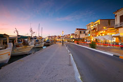 Aegina island. View of the seafront with coffee shops, bars and restaurants and fishing boats in the harbour of Aegina island, Greece Stock Images