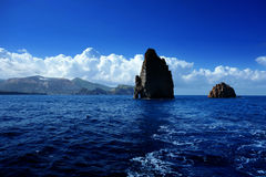 Aeolian Islands, two cliffs near Vulcano Island (in the background) Stock Images