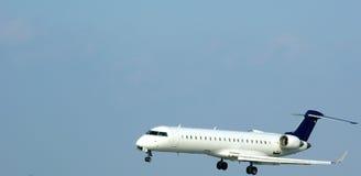 Aeorplane landing. Aeroplane landing during moderate wind royalty free stock images