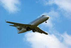 Aeorplane on sky. Aeroplane seen from ground on blue sky Stock Photos