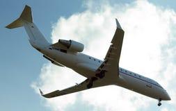 Aeorplane sul cielo Fotografia Stock