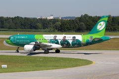 Aer Lingus Airbus A320 airplane special livery Green Spirit Rugby Team. Munich, Germany - August 8, 2016: An Aer Lingus Airbus A320 with the registration EI-DEO royalty free stock photos