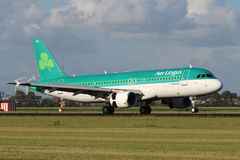 Aer Lingus Airbus A320. AMSTERDAM - JULY 01: Aer Lingus Airbus A320 lands at AMS Airport in Netherlands on July 01, 2012. Aer Lingus is the national flag carrier royalty free stock image