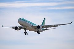 An Aer Lingus Airbus A330-200 Front Profile. Photo of an Aer Lingus Airbus A330-200 on final approach to Toronto Pearson International Airport. The A332 is the royalty free stock photo