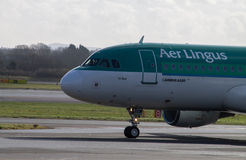 Aer Lingus Airbus A320. Manchester, United Kingdom - February 16, 2014: Aer Lingus Airbus A320 arriving to Manchester Airport, front part of the plane royalty free stock images