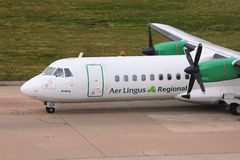 Aer Lingus. BIRMINGHAM, UK - APRIL 24: Pilots taxi Aer Lingus ATR 72 on April 24, 2013 at Birmingham Airport, UK. Aer Lingus flew 9.5 million passengers in 2011 Stock Photography
