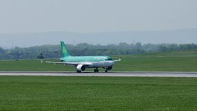 Aer Lingus doing taxi on runway. Aer Lingus is the flag carrier airline of Ireland and the second-largest airline in the country stock footage