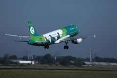 Aer Lingus Irish rugby livery plane taking off. Aer Lingus Irish rugby livery plane takes off from runway, airport stock images