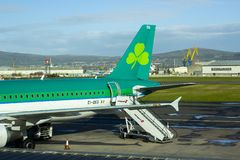 An Aer Lingus jet with livery sits on the apron at Belfast City stock image