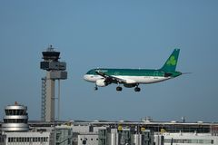 Aer Lingus landing on airport. Aer Lingus lands on airport, buildings under jet stock images