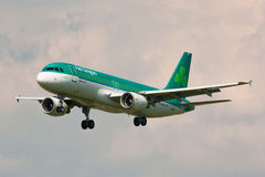 A320 Aer Lingus. PRAGUE, CZECH REPUBLIC - APRIL 23: A320 Aer Lingus lands at PRG Airport on April 23, 2014. Aer Lingus is the national flag carrier of Ireland stock photography