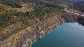 Aerail view on river lake shore plants. Aerial View of Forest Along Edge of Blue Lake. Green forest river shore. Landscape royalty free stock images