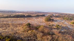An aerail view of the Studland Nature Reserve with sand dune, peat bog and sea under a majestic hazy blue sky.  royalty free stock photos