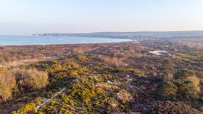 An aerail view of the Studland Nature Reserve with sand dune, peat bog, sea and white cliff in the background under a majestic blu. E sky royalty free stock photo