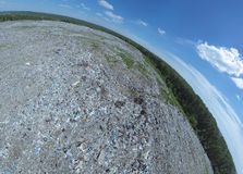 Aeral pamoramic view to a huge garbage dump stock image