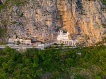 Monastery of Ostrog is a monastery of Serbian Orthodox Church placed against an almost vertical rock of Ostroska Greda, Montenegro royalty free stock image