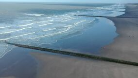 Aeral view of the waves of the calm north sea sandy beaches