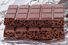 Aerated chocolate on foil Royalty Free Stock Images