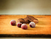Aerated chocolate with frozen wine cherry, selective focus Stock Image