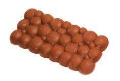 Aerated chocolate. Milk aerated chocolate isolated on white Stock Image