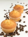 Aerated cupcakes isolated on white background. excellent breakfast. fresh bakery. with scattered coffee beans. stock photo