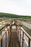 Aeration process in basin with dirty sewage water. Aeration process of waste sewage water treatment plant. Huge basin with bubbling dirty water. Aerotank grit Royalty Free Stock Images