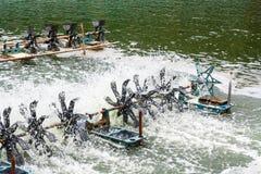 Aeration turbines in the shrimp farm Stock Photography