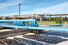 Aeration of wastewater in sewage treatment plant. Blue oxygen pipelines Stock Photo