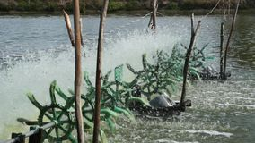 Aerator Water Turbines Supplying Fish Pond With Oxygen stock video footage