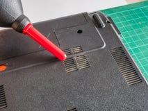 Aeratore di Dusty Laptop Fan With Rocket di pulizia fotografia stock libera da diritti