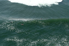 Aereal view of surfers during a contest. In the Gringo wave in Arica, Chile Stock Images