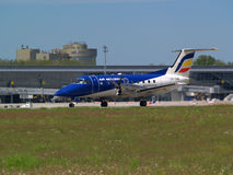 Aerei di partenza di Embraer EMB-120RT Brasilia di linee aeree di Air Moldova Immagine Stock