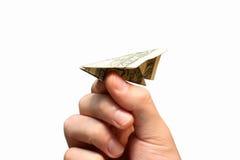 Aereo del dollaro della holding della mano Fotografia Stock Libera da Diritti
