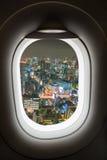 Aereo della finestra con la vista di paesaggio urbano Fotografia Stock