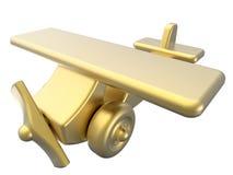 Aereo dorato del giocattolo Immagini Stock