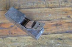 Aereo nel backgroud di legno Immagini Stock
