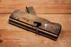 Aereo su una tavola di legno Fotografie Stock Libere da Diritti