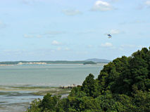 Aerial view - Chek Jawa. A helicopter flying over a viewing platform and boardwalk at Chek Jawa wetlands, where visitors explore marine life on the exposed Stock Images