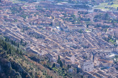 Aeria view of the small town of Gubbio with the Consoli's Palace. Blue sky with clouds, Umbria, Italy royalty free stock photo