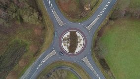 Aeria view of a traffic circle. Aerial view of a traffic circle - cars and trucks driving through stock video