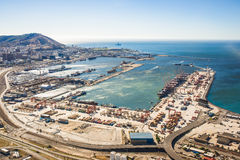 Aerial. Shot of Harbour with cranes, cargo ships and workers Royalty Free Stock Photos